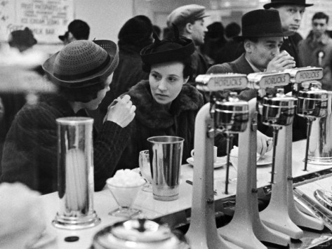 pair-of-women-chatting-over-coffee-at-a-restaurant-counter